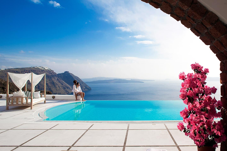 Infinity crystal clear pool overlooking the Aegean sea at San Antonio Santorini.