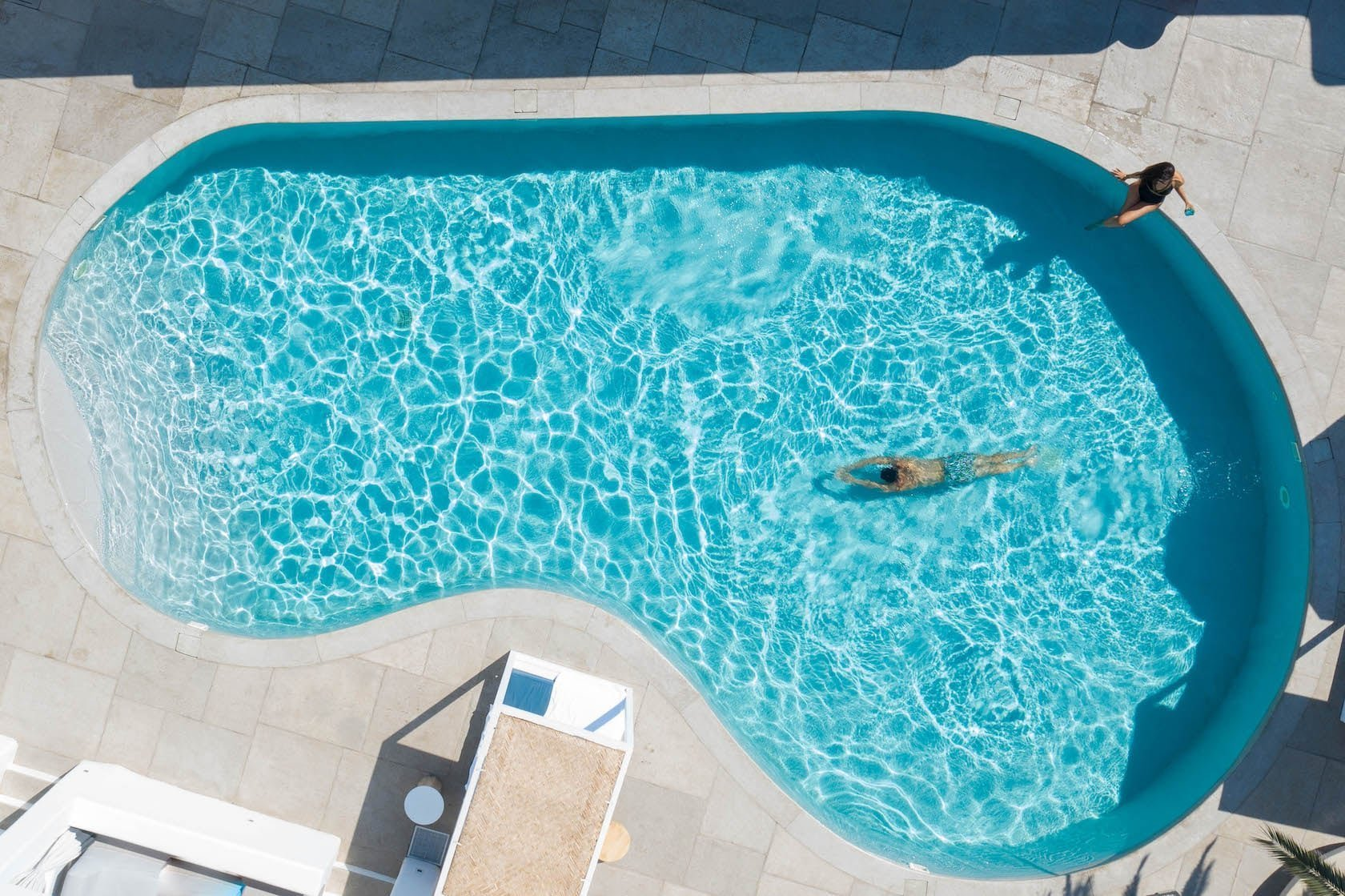 Overhead view of the heart shaped swimming pool in Mykonos Ammos Beachfront Hotel.