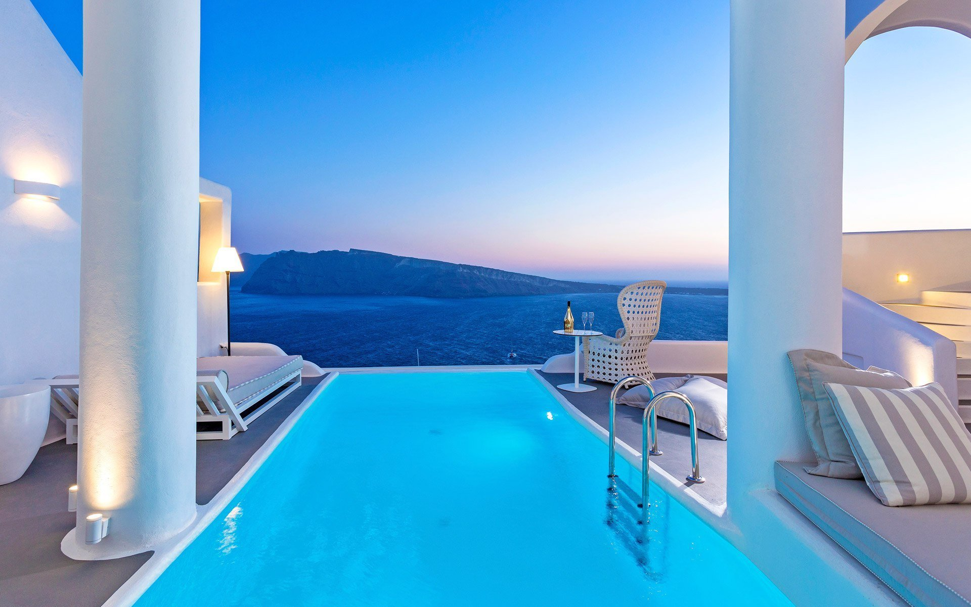Private pool and outdoor sitting area overlooking the sea at Charisma Suites Oia Santorini.