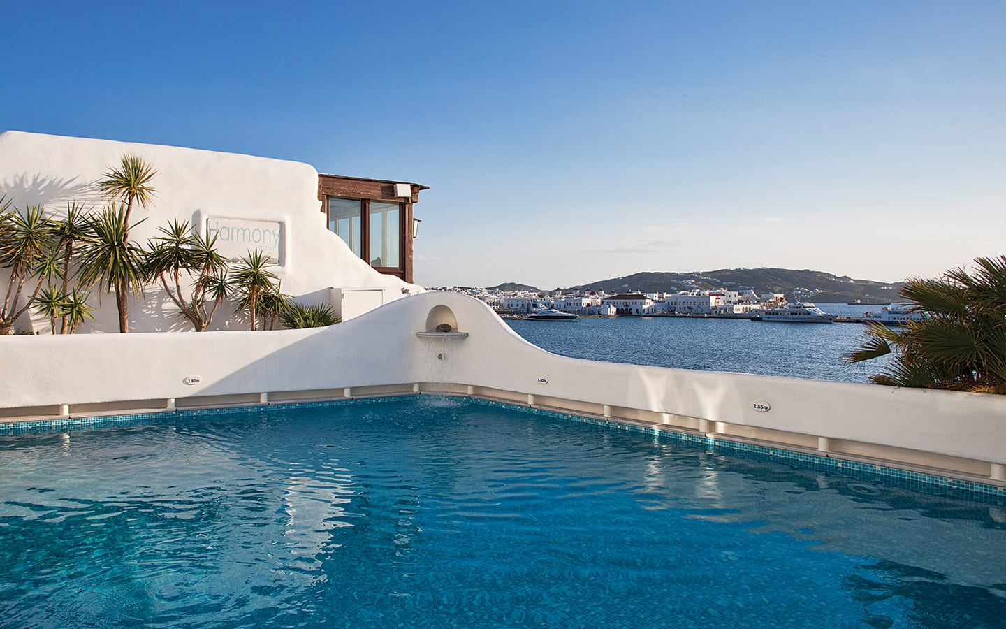 Crystal clear pool overlooking the sea at Harmony Boutique Hotel Mykonos.