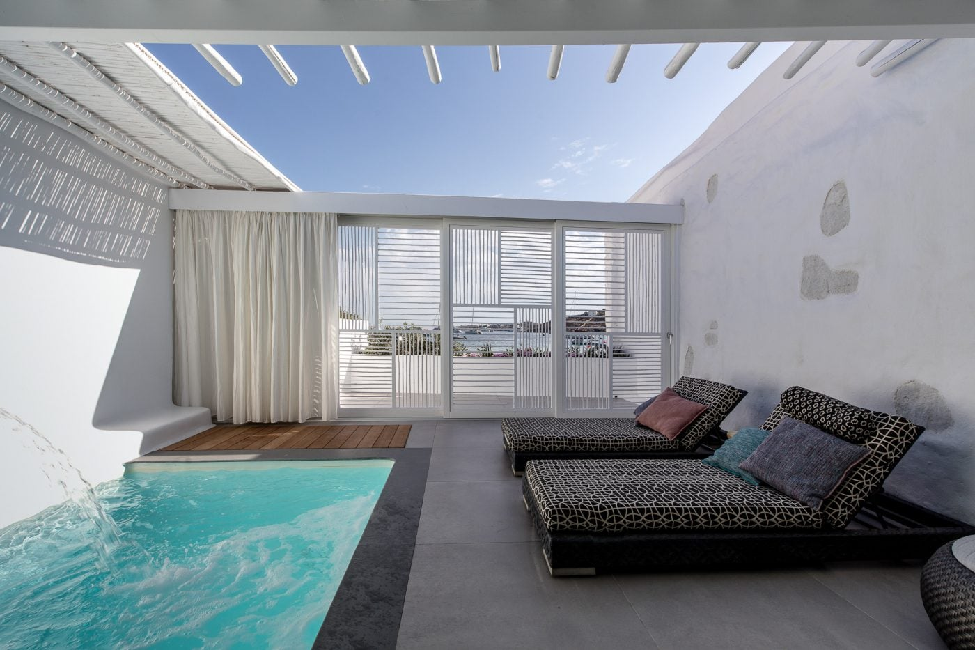 Pool and sunbeds in the private veranda of a luxury room in Mykonos Blanc Hotel